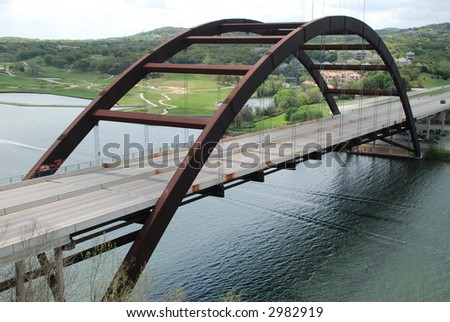 """Austin's 360 Bridge"" also known as the ""Austin Pennybacker Bridge"" overlooks town lake along the Colorado River. Is the only one of its kind, it does not touch the water. - stock photo"