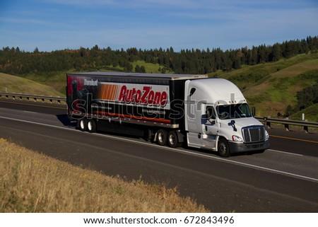 A Truck: A Truck Pulls A Trailer
