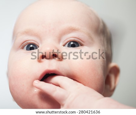 baby boy finger sucking mouth - stock photo