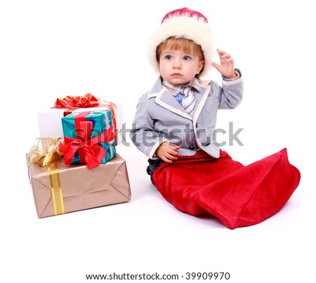 Baby boy sitting with Christmas present - stock photo