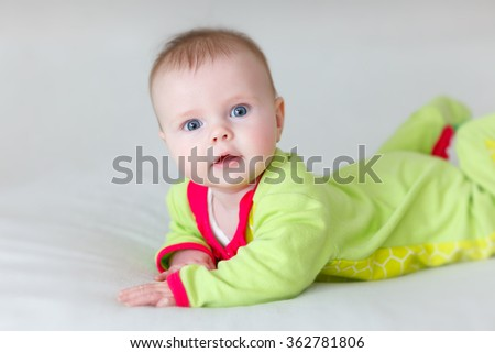 baby on a blanket with eyes wide open - stock photo