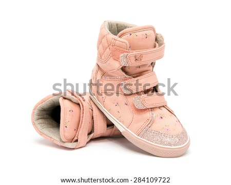 baby sneakers on white background
