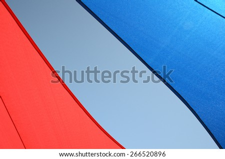 Back-lit Colorful Red, White and Blue Tent - stock photo