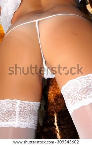 Back of a slim woman wearing lingerie. Perfect sexy buttocks. Woman take off her panties. sexy butt girls in underwear. closeup of beautiful woman buttocks with path - stock photo