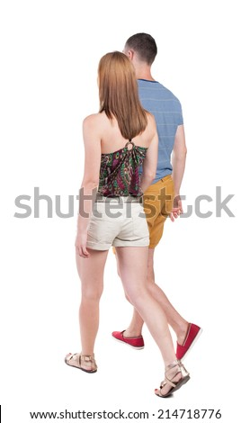 Back view going couple in shorts. walking friendly girl and guy holding hands. Rear view people collection. backside view of person. Isolated over white background.