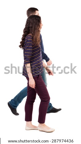 Back view going couple. walking friendly girl and guy holding hands. Rear view people collection. backside view of person. Isolated over white background. man and woman go together from left to right