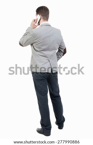 back view of business man in suit  talking on mobile phone.    rear view people collection. Isolated over white background. backside view of person. Businessman solves the case by telephone. - stock photo