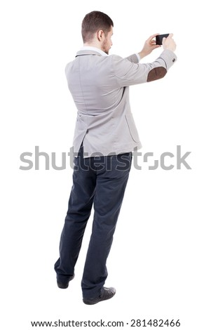 back view of business man on phone photographs. rear view people collection. Isolated over white background. backside view of person.  A bearded man in a suit photographed telephone. - stock photo