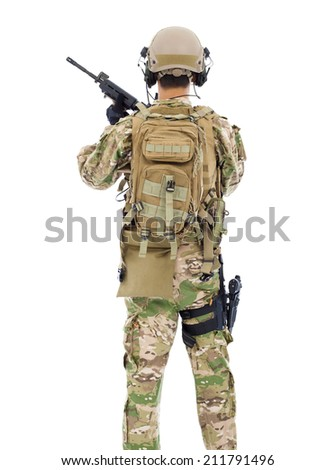 back view of soldier with rifle or sniper over white background - stock photo