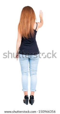back view redhead woman. Young woman presses down. Isolated over white background. Rear view people collection. backside view of person. she holds his hand open, palm forward - stock photo