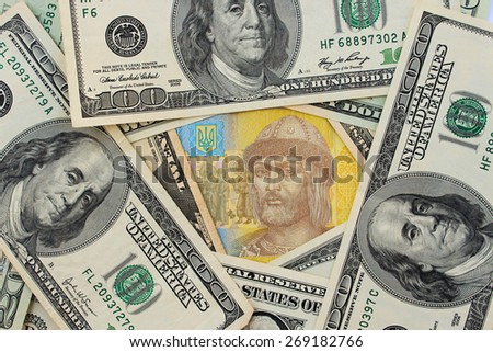 Background different banknotes of us dollars and Ukrainian hryvnia - stock photo