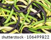 background: mix of green, yellow and black wax beans - stock photo