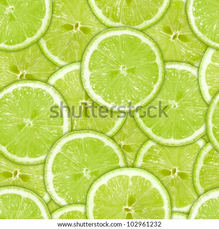 background of heap fresh green lime slices. Seamless pattern for your design. Close-up. Studio photography. - stock photo