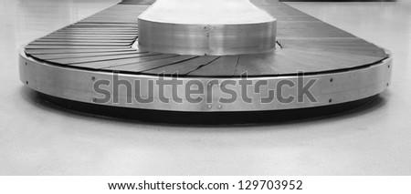 bag conveyor in airport - stock photo