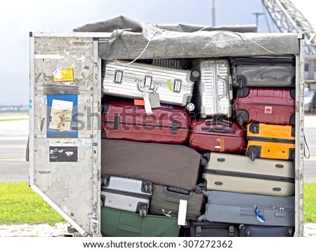 Baggage fully loaded in cargo container - stock photo