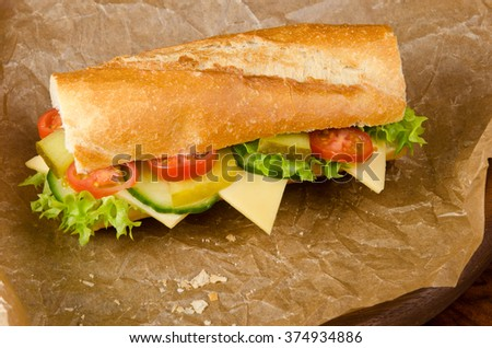 baguette with lettuce and cheese cucumber and tomatoes, sandwich