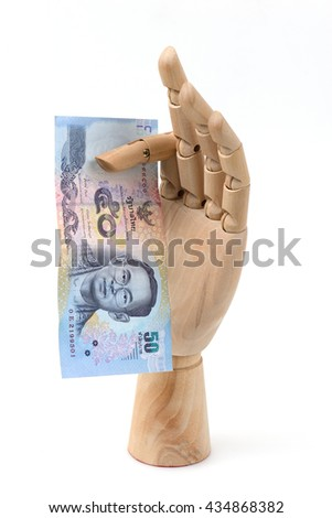 50 baht banknotes , Thai money  in hand wood on the white background