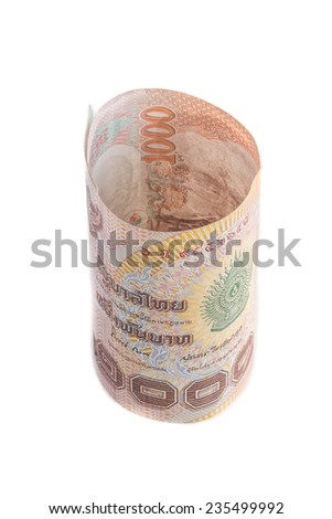 1000 Baht Rolls of banknote of Thai currency - stock photo