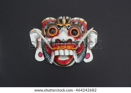 ?Balinese mask; a dramatic form of Indonesian dance  A colorful carved wooden Bali wall Art is based on a traditional style in antique white and red touched of gold leaf