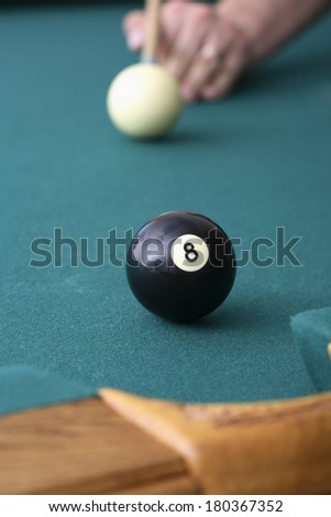8 ball and cue ball on billiards table