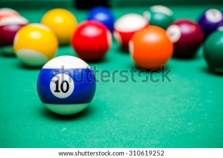 10 Ball from pool or billiards on a billiard table - stock photo