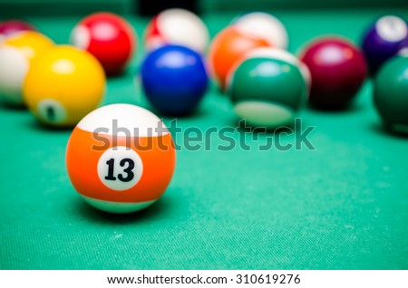 13 Ball from pool or billiards on a billiard table - stock photo