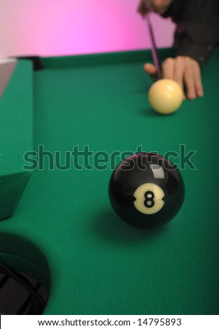 8 Ball in the side pocket on a pool (billiards) table during play