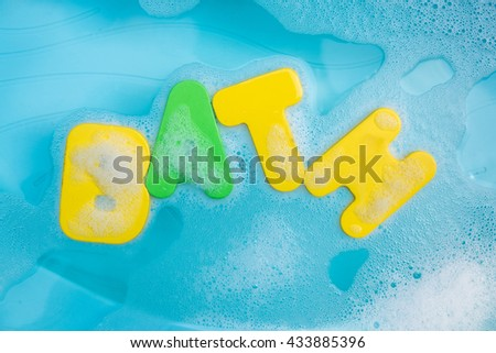 """""""Bath"""" letters floating in soapy water - stock photo"""