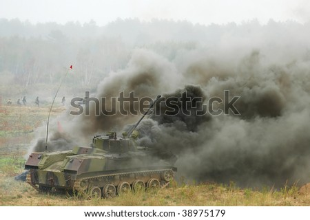 Battle-field. disabled tank  during the military training exercise - stock photo