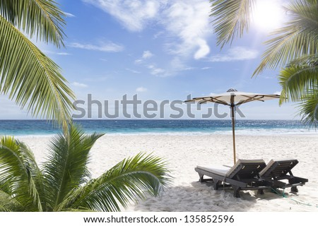 Beach chair at sunny coast. Seychelles. Mahe island.