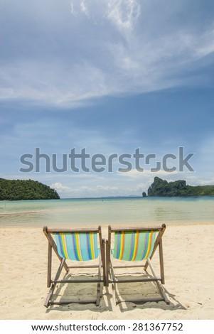 2 beach chairs on tropical island beach - stock photo