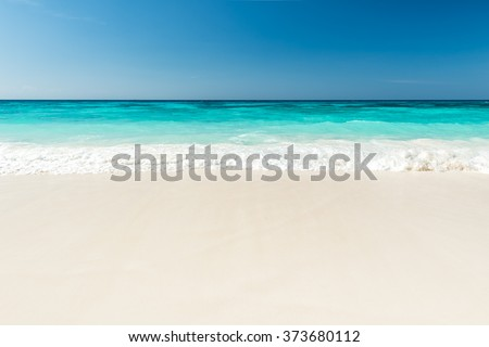 Beautiful beach and tropical sea, Wave of the sea on the sand beach - stock photo
