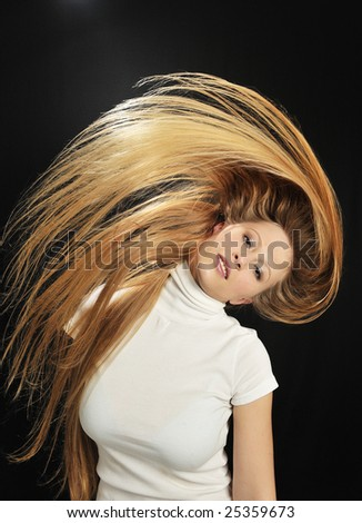 Beautiful blond girl with gorgeous long hair - stock photo