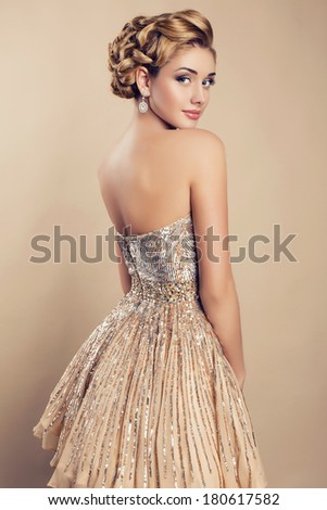 beautiful blond woman in elegant sequin dress - stock photo
