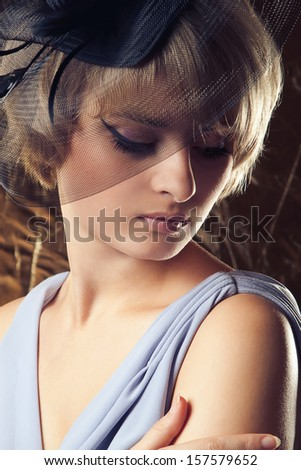 Beautiful blonde woman. Portrait in retro style.