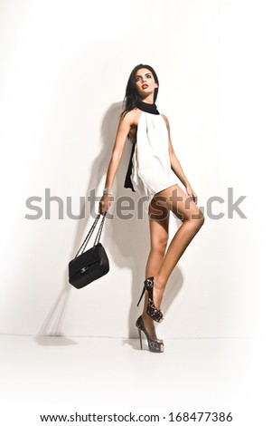 Beautiful Brunette Girl. Healthy Long Hair. Beauty Model posing fashion with white dress - stock photo