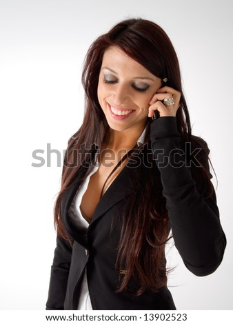 Beautiful business girl calling and speaking to mobile phone. - stock photo