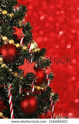 Beautiful decorated Christmas tree on glitter background - stock photo