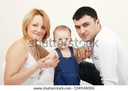 Beautiful family portrait smiling -  over a white background - stock photo