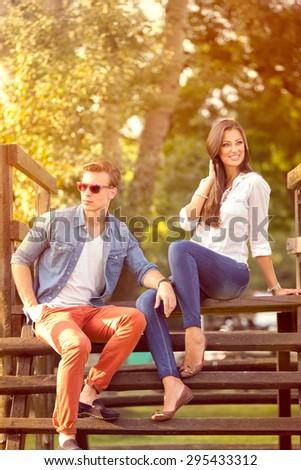 Beautiful  fashion couple in park - stock photo