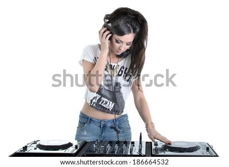 Beautiful female DJ adjusting sound levels - stock photo