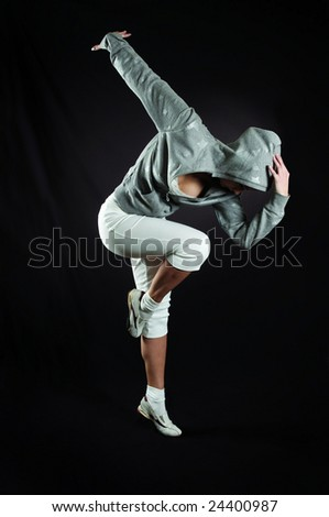beautiful girl executes modern dance - stock photo