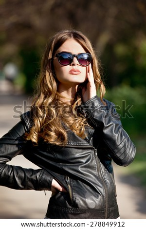 Beautiful girl in the sunset outdoor on the street. Woman in city. - stock photo