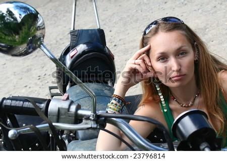 beautiful girl on a motorbike - stock photo