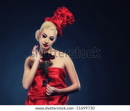 Beautiful lady with a rose - stock photo