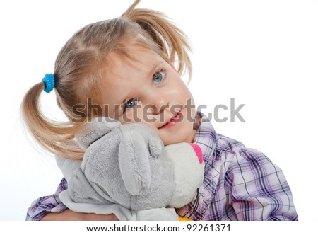 beautiful little girl with a plush dog - stock photo