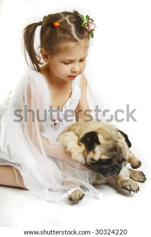 Beautiful little girl with dog breed pug