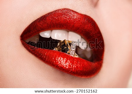 Beautiful red glossy lips close-up, macro photography - stock photo
