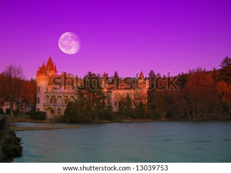 Beautiful romantic castle with river and forest in night with a moon - stock photo