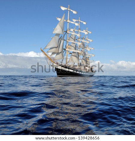 Beautiful sailing ship on the waves - stock photo